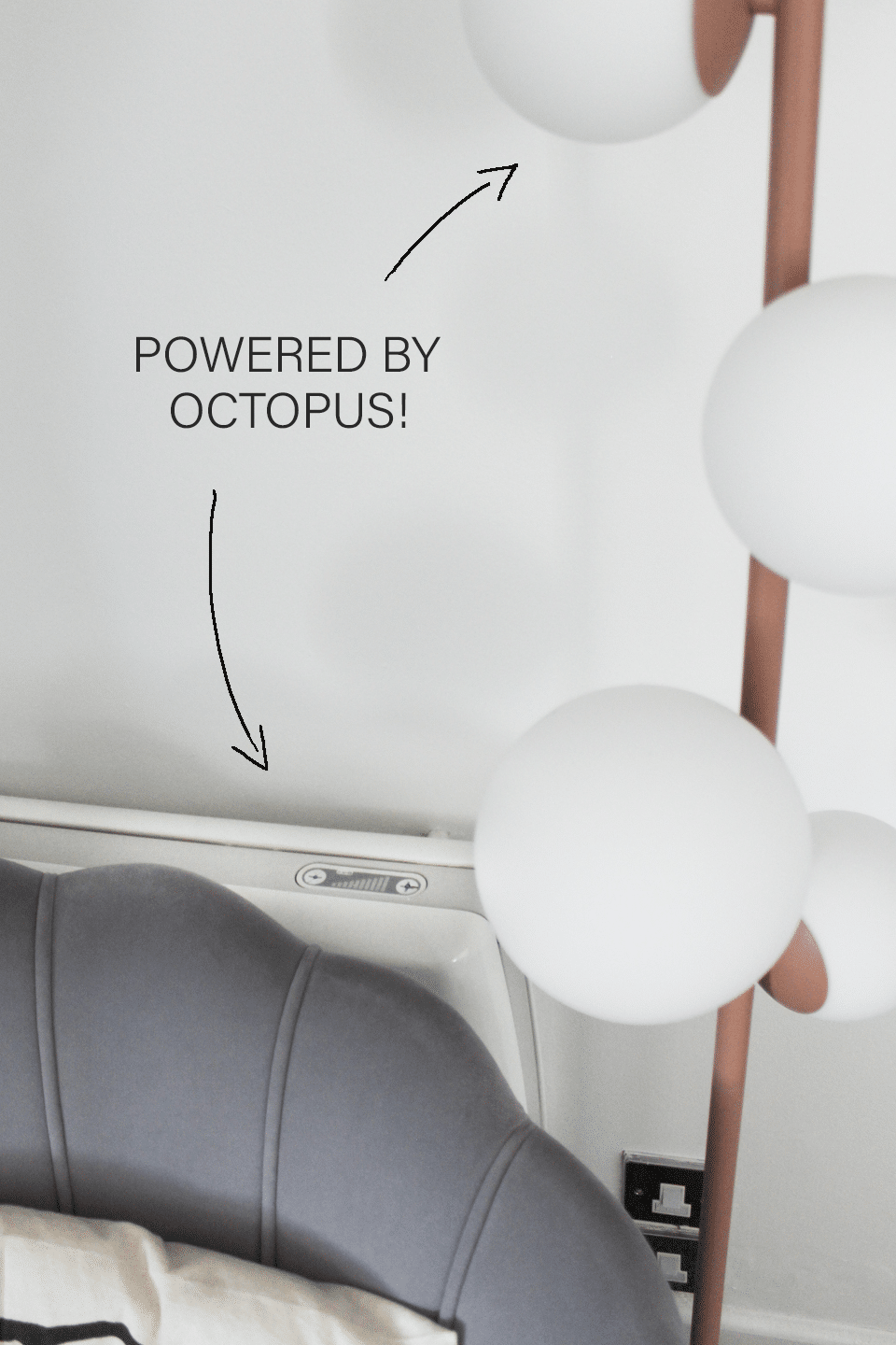 """Electric light and heater with annotated words """"Powered by Octopus!"""""""