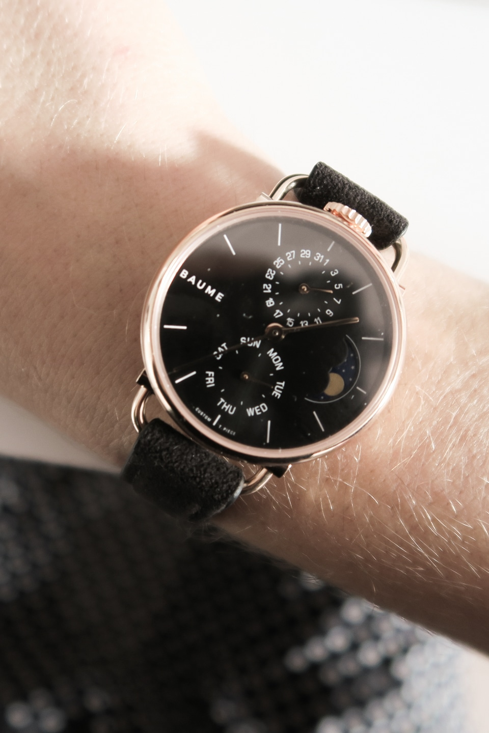 Close-up of BAUME watch face