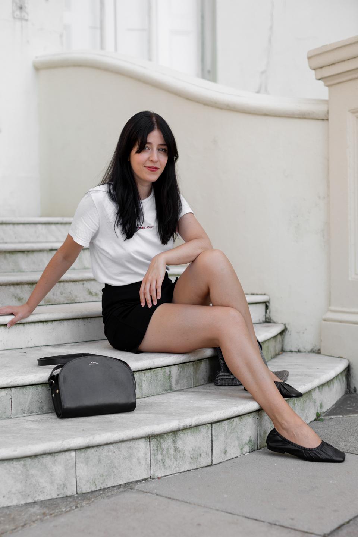 Besma sat on steps smiling