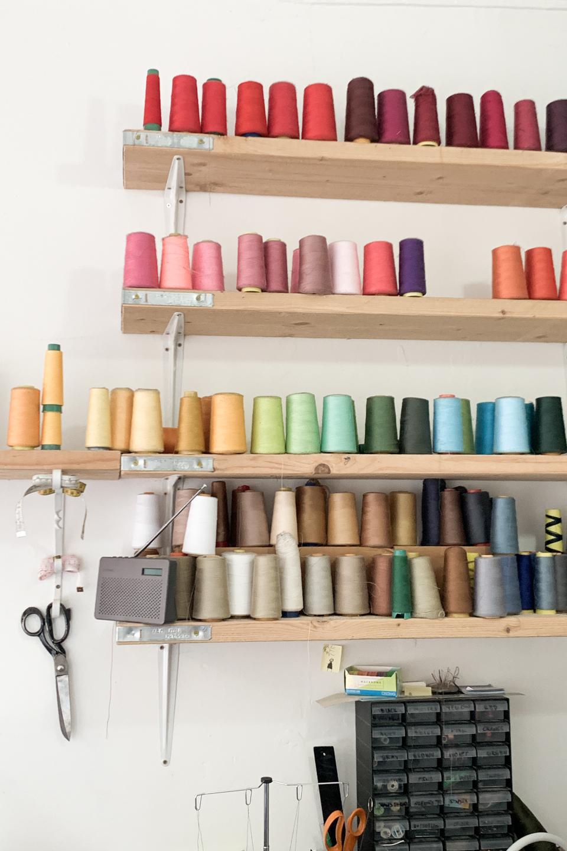 Spools of thread at a clothes alterations shop