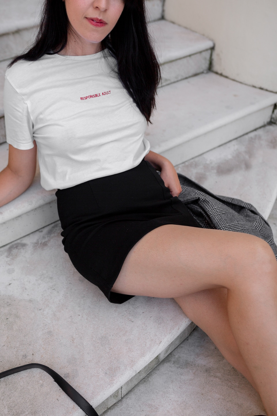 Close-up of t-shirt and skirt outfit