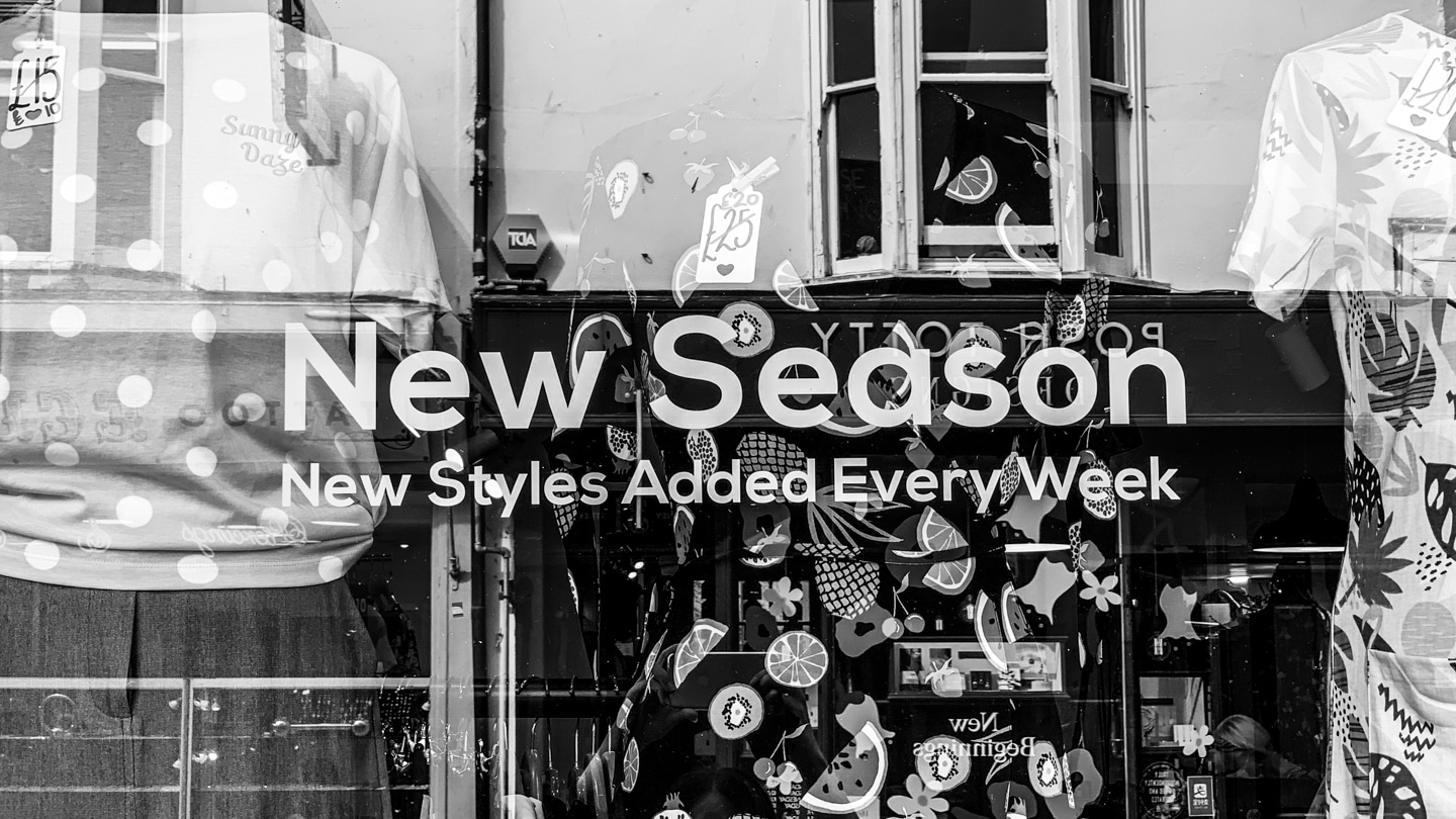 Shopfront with text 'New Season New Styles Added Every Week'