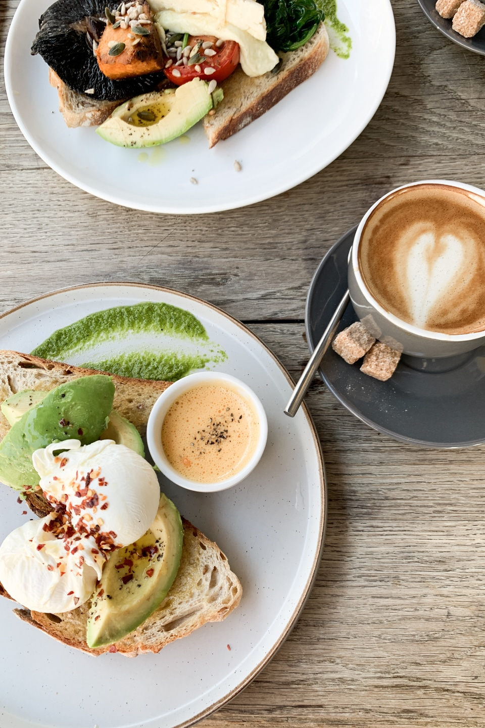 Flat-lay of brunch food prepared by Café Rust