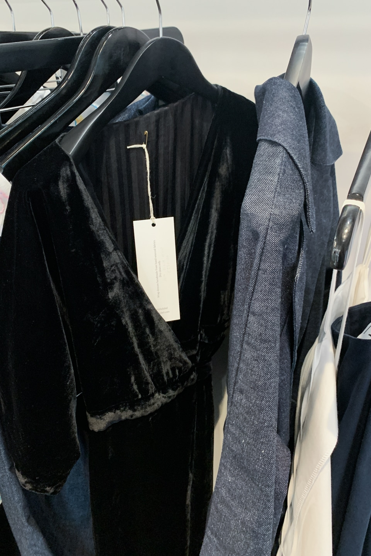 Garments on rails at Ensemble