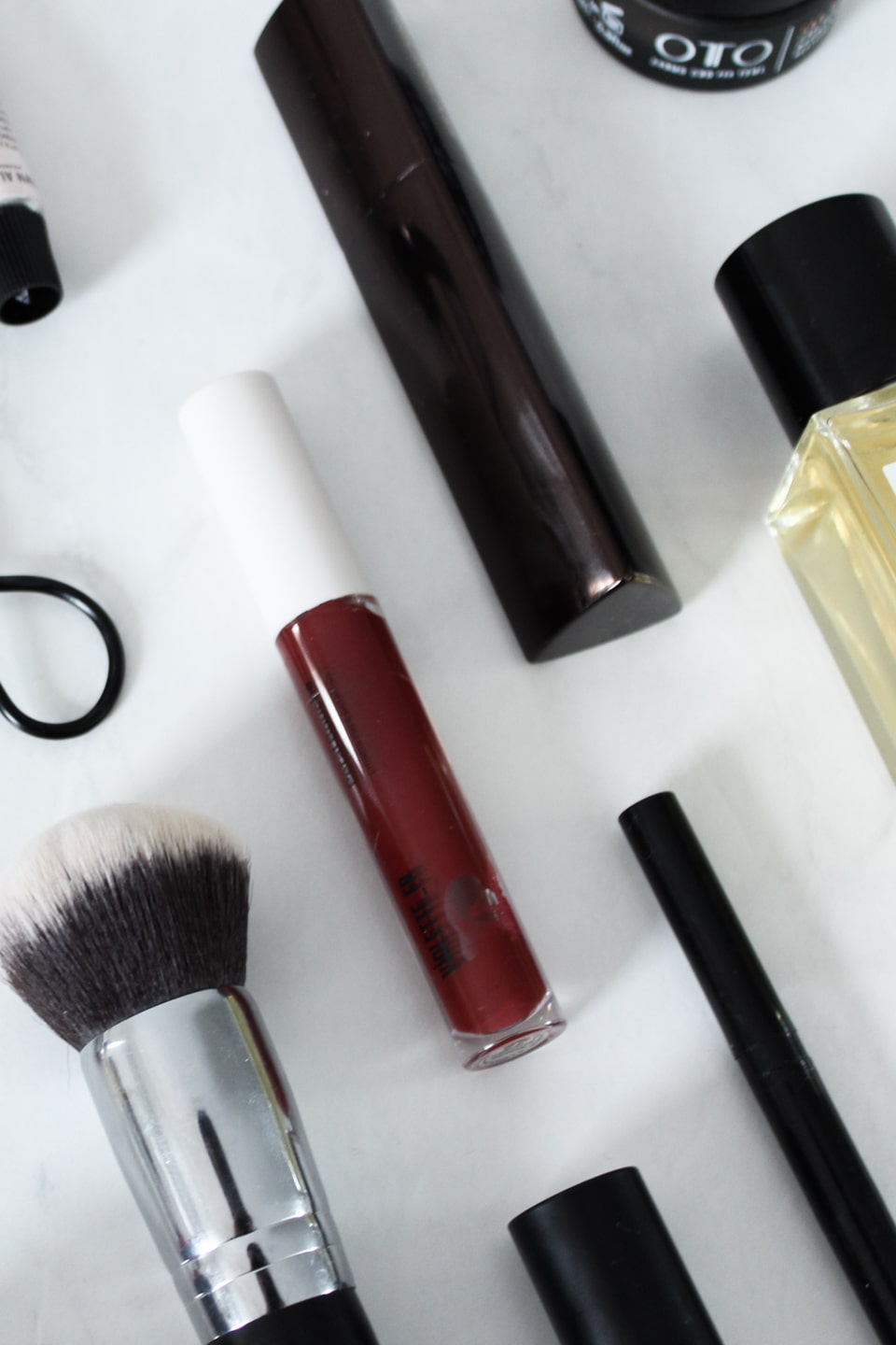 Clean beauty products in a flat lay